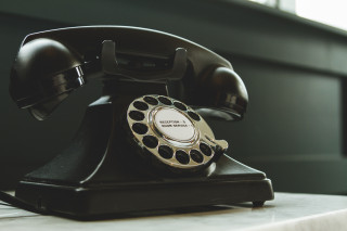 black-rotary-telephone-on-white-surface-1416530